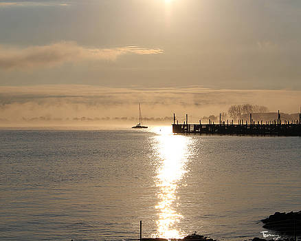 Mist Rising over the Pier by Tammy Kuiper