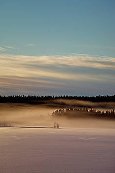 Misty frozen lake at sunset by Ulrich Kunst And Bettina Scheidulin