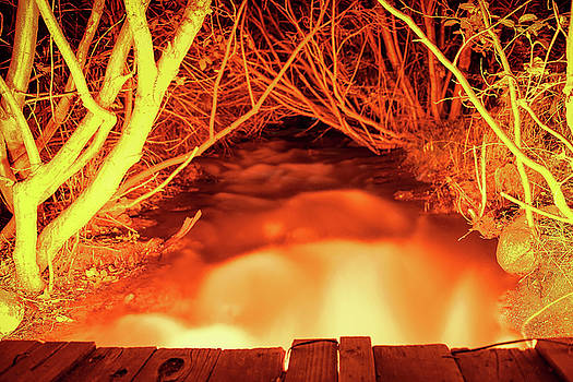 Mo Fiyah, Looking up from a small bridge over an Illuminated Creek during Summer in South Reno, NV by Brian Ball