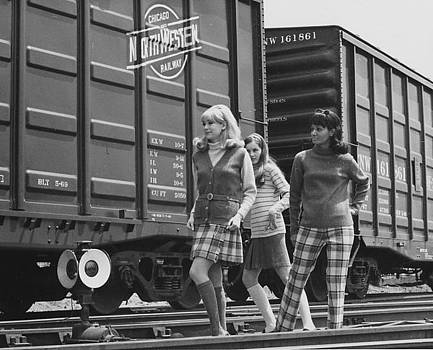 Chicago and North Western Historical Society - Models Pose Beside Box Cars