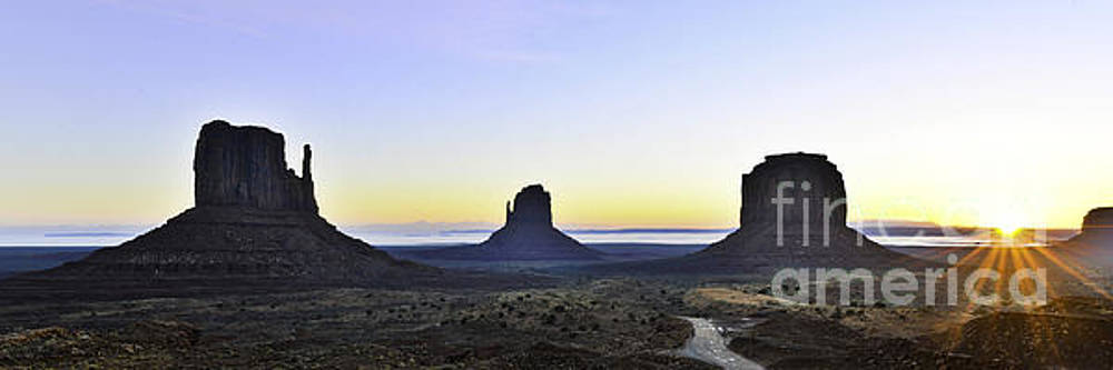 Monument Valley At Sunrise Panoramic by Peter Dang