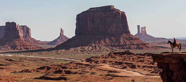 Monument Valley Man on Horse Sunrise  by John McGraw