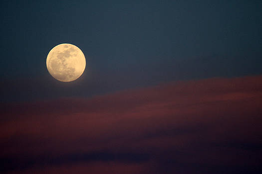Moon through haze by Kevin Snider