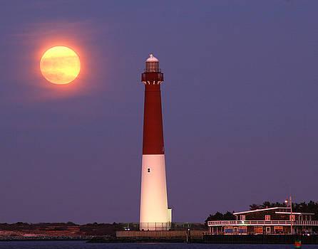 Moonrise Over Barnegat Lighthouse by Kelly S Andrews