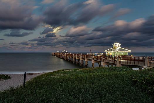 Moonrise over Juno Beach Pier by Claudia Domenig