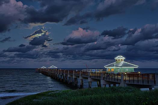 Moonrise over Juno Beach Pier II by Claudia Domenig