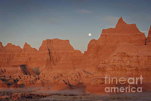 Moonset Badlands National Park by Joan McCool