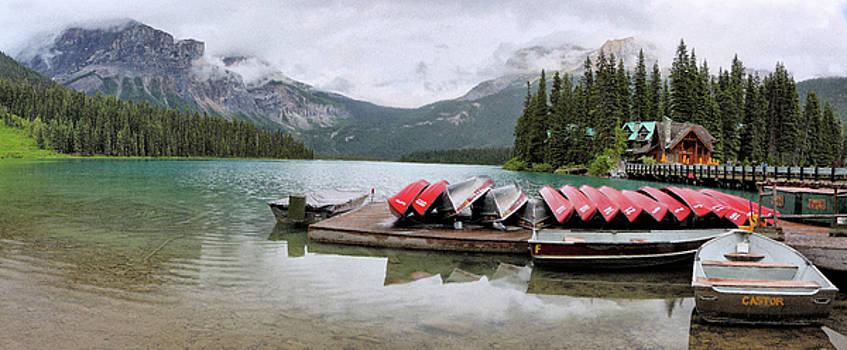 Moraine lake canoes and fog by Jack Nevitt