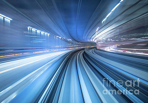 Motion blur of train moving inside tunnel in Tokyo, Japan by Noppakun Wiropart