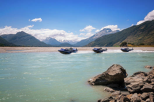Motorboats on Dart River in New Zealand by Daniela Constantinescu