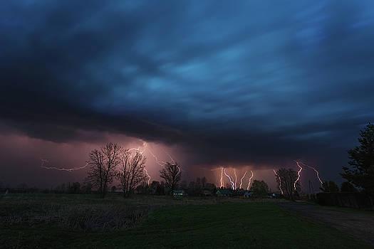 Multiple lightning strikes under dramatic cloudy sky by Lukasz Szczepanski