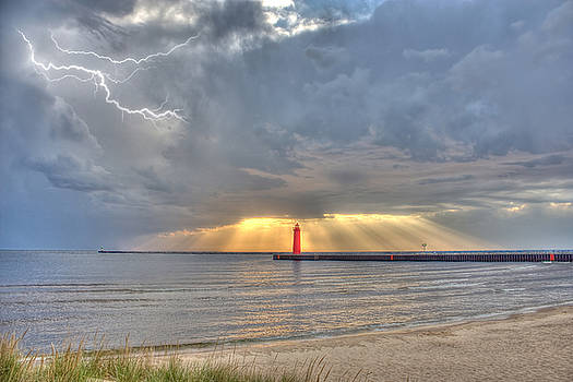 Muskegon Lighthouse Lightning and Radiance Sunset by Jeramie Curtice