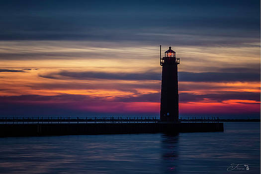 Muskegon Pier Lighthouse Sunset Michigan by J Thomas