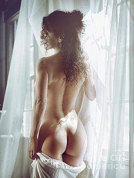 Naked back of a beautiful half nude woman standing by the window by Oleksiy Maksymenko