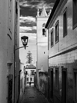 Narrow Street and Bell Tower in Tavira - Portugal by Barry O Carroll