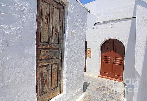 narrow street in Greek village by Susan Wall