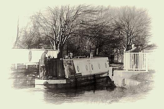 Narrowboat passing through  by Susan Tinsley