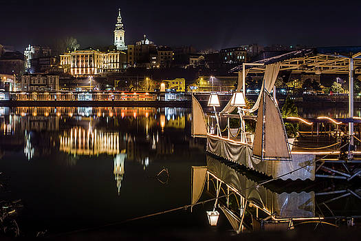 Near-perfect Belgrade reflection in the Sava River by Dejan Kostic