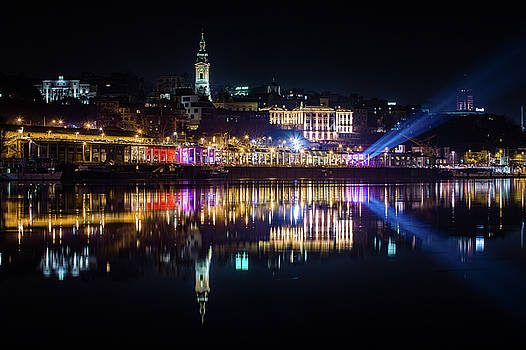 Near-perfect reflection of Belgrade downtown in the Sava River by Dejan Kostic