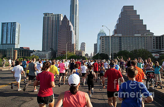 Herronstock Prints - Nearly 23000 runners and joggers run past the Congress Ave. Bridge in an annual 10K race in downtown Austin Texas