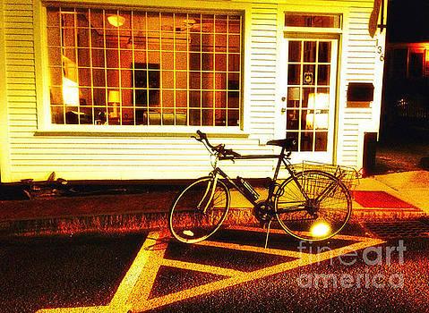Night Biking on Commercial Street in Provincetown by John Castell