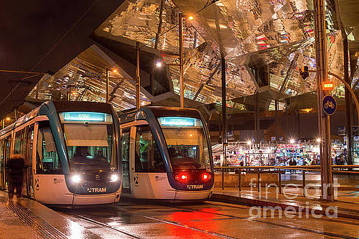 Night view of two trams at Glories station  by Andrew Michael