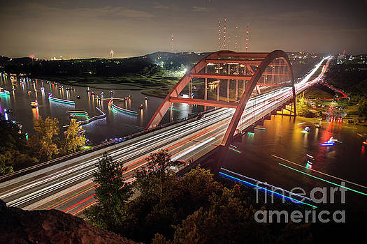 Herronstock Prints - Nighttime boats cruise up and down the Loop 360 Bridge, a boater