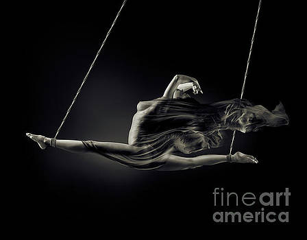 Nude woman swinging in splits in the air with bondage rope and f by Oleksiy Maksymenko