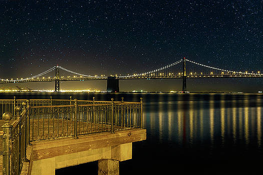 Oakland Bay Bridge by the Pier in San Francisco at Night by David Gn