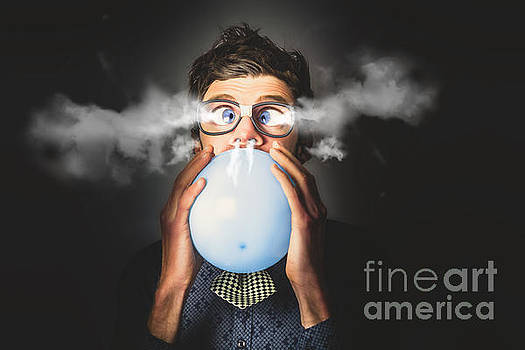 Office party nerd blowing up birthday balloon by Jorgo Photography - Wall Art Gallery