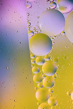 Oil in water by Kevin Blackburn