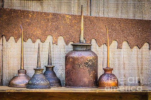 Oiling cans by Tony  Bazidlo