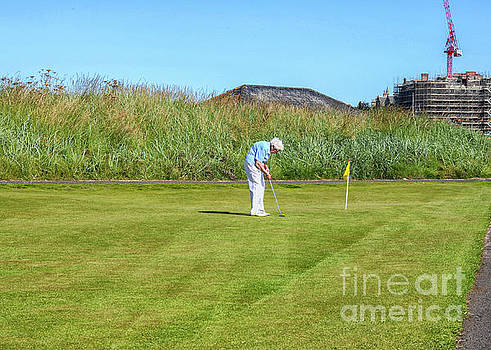 Old aged woman playing golf by Patricia Hofmeester