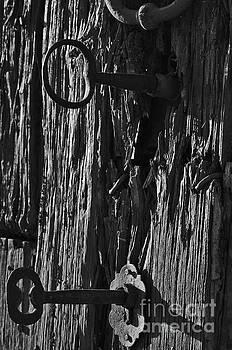 Angelo DeVal - Old and abandoned wooden door with skeleton keys