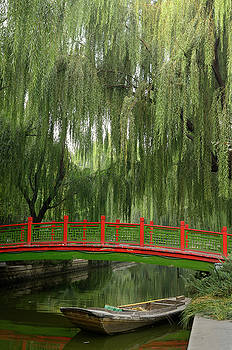Reimar Gaertner - Old bridge and boat with willow trees in Changpu river park Beij