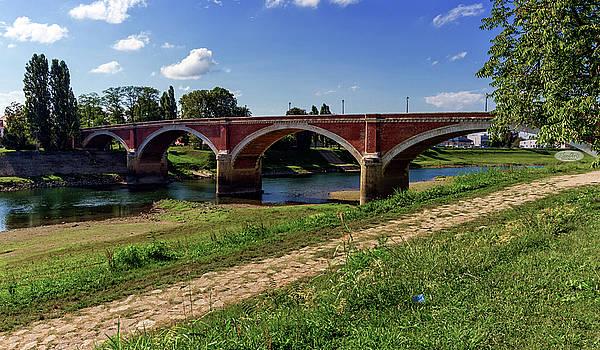 Elenarts - Elena Duvernay photo - Old bridge over the Kupa river in Sisak, Croatia
