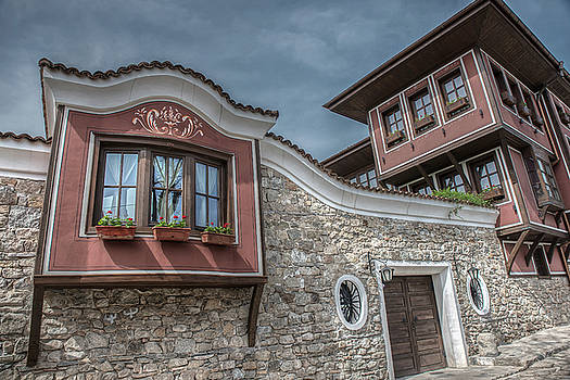 Old city street view with colorful buildings in Plovdiv, Bulgaria by Julian Popov