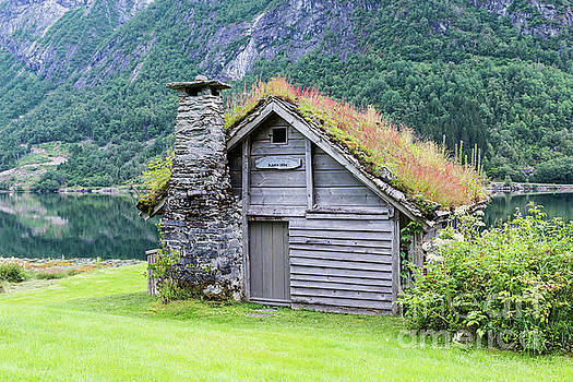 Old Fairytale Like House Of Wood With Chimney Of Stacked Slate   by Compuinfoto
