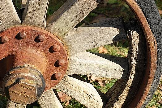 Old Farm Wheel by Peter  McIntosh