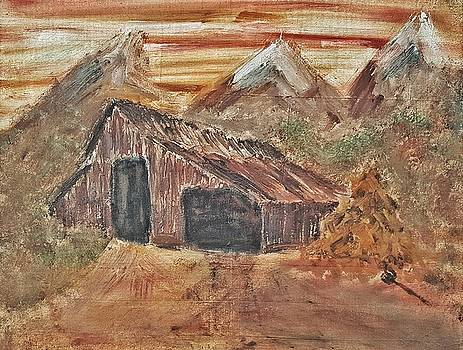Old Farmhouse with Hay stack in a snow capped mountain range with tractor tracks gouged in the soft  by MendyZ