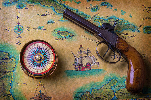 Old Gun And Compass On Map by Garry Gay