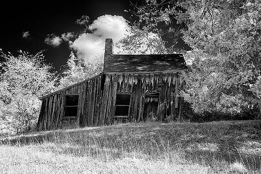 Old house on a hill by Paul Seymour