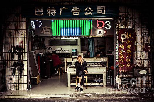 Old man sit outside the printmaker by Adrian Baljeu