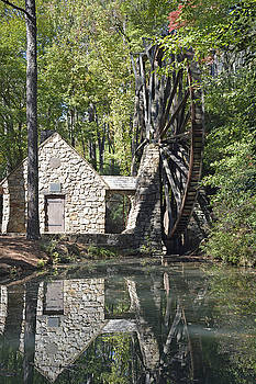Old Mill Waterwheel Reflected in Pond by Bruce Gourley