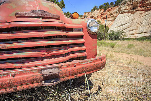 Old red Chevrolet Outside Zion National Park Utah by Edward Fielding