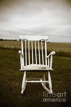 Edward Fielding - Old rocking chair in a field PEI