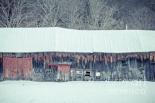 Old sagging barn in winter by Edward Fielding