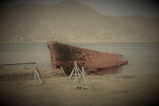 Old ship on beach  by Jon Thor Gudmundsson