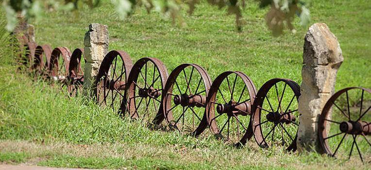 Old Steel Wagon Wheel Fence by Chad Davis
