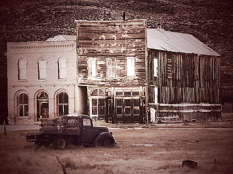 Old Buildings with Truck Sepia by Alan Socolik